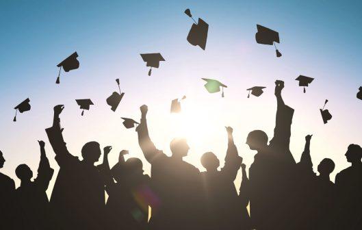 GraduationHatsThrownIntoTheAir-1400x891